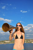 Girl shouting into a megaphone Stock Photos