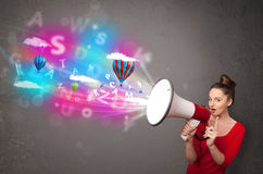 Girl shouting into megaphone and abstract text and balloons come Royalty Free Stock Photos