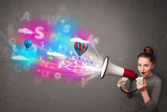 Girl shouting into megaphone and abstract text and balloons come Stock Images