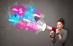 Girl shouting into megaphone and abstract text and balloons come Stock Photos