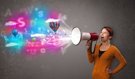 Girl shouting into megaphone and abstract text and balloons come out. Cute girl shouting into megaphone and abstract text and balloons come out royalty free stock photography