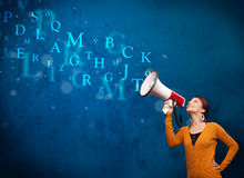 Girl shouting into megaphone and abstract text come out Royalty Free Stock Image