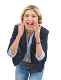 Girl shouting through megaphone shaped hands Royalty Free Stock Photography