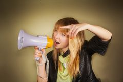 Girl shouting over a megaphone Stock Photo