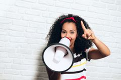 Girl Shouting Screaming Yelling With Megaphone For Promotion Advertising stock photo