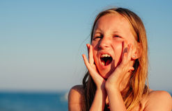 Girl shouting Stock Images