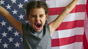 Girl shouting teen holding usa American flag. Girl  shouting teen holding usa American flag stock video footage