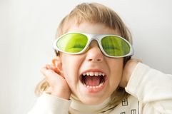 The girl shouts. The girl in sun glasses, emotional royalty free stock photo