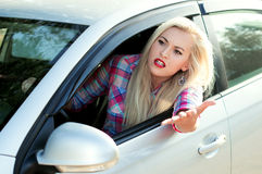Girl shouts while driving Royalty Free Stock Photography