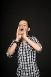 Girl shouts using hands Stock Photography