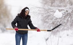 Girl with a shovel cleans the snow.  Stock Photo
