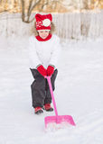 Girl shoveling snow. Royalty Free Stock Image
