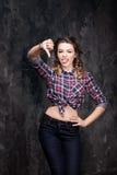 Girl show bad sign. Thumb down. Checkered shirt Royalty Free Stock Photography