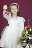 Girl show Christmas asterisk Stock Photos
