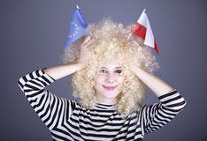 Girl show EU and Poland flag. Beautiful girl with ringlets show European Union and Poland flag. Studio shot Stock Images