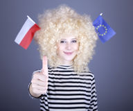 Girl show EU and Poland flag. Beautiful girl with ringlets show European Union and Poland flag. Studio shot Stock Photography