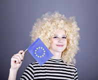 Girl with show European Union flag. Beautiful girl with ringlets show European Union flag. Studio shot Royalty Free Stock Photos
