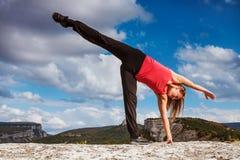 Girl show half moon yoga pose Stock Photography