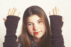 Girl show hands in woolen fingerless mittens Royalty Free Stock Image