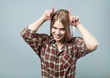 Girl show horns Stock Photos