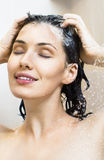 Girl at the shower Stock Images