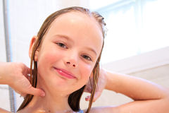 Girl in shower. A little girl washing her hair in the shower Royalty Free Stock Photography