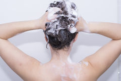 Girl in the shower. Girl washing her hair in the shower Stock Images