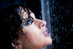 Girl in the shower with water drops set. Black background Stock Photos