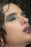 Girl in the shower with water drops set. Black background Royalty Free Stock Photography