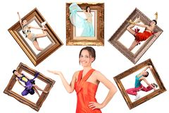 Girl showes multi task many women in picture frame. Beauty girl in red dress showes multi task many women in picture frames collage stock photos