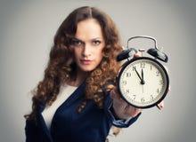 Girl showing alarm clock Stock Photos