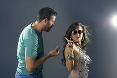 Girl showing arrogance to a guy pleasing her.  Royalty Free Stock Photos