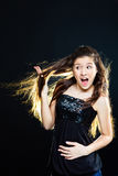 Girl showing  beautiful healthy hair  on black Royalty Free Stock Photography