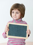 Girl Showing a blackboard Royalty Free Stock Photography