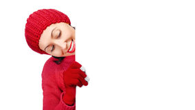 Girl showing a blank banner. Girl in winter clothes showing a blank banner Royalty Free Stock Images