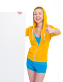 Girl showing blank billboard and thumbs up Royalty Free Stock Photo