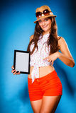 Girl showing blank copy space screen of tablet touchpad Royalty Free Stock Image