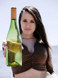 Girl showing a bottle Stock Photos