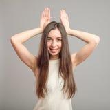 Girl showing bunny ears Stock Photo