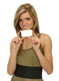Girl showing business card Royalty Free Stock Photos