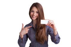 Girl showing a business card in hand. Cute girl showing a business card in hand Stock Images
