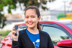 Girl showing the car key. Royalty Free Stock Images