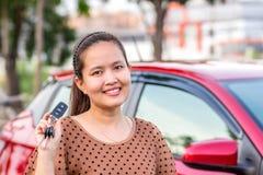 Girl showing the car key. Stock Photos