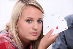 Girl showing cards Stock Photography