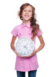 Girl showing clock and smiling Royalty Free Stock Photography