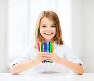 Girl showing colorful felt-tip pens Royalty Free Stock Photography