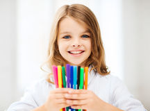 Girl showing colorful felt-tip pens. Education and school concept - little student girl showing colorful felt-tip pens at school stock photos