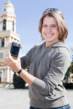 Girl showing compact camera screen Royalty Free Stock Photo
