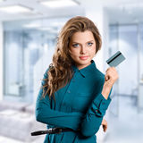 Girl showing credit card Royalty Free Stock Photography