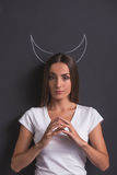 Girl showing devil Royalty Free Stock Photos